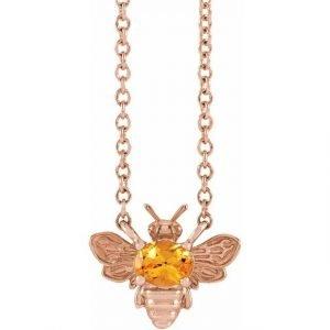 rose gold bee pendant necklace with orange garnet