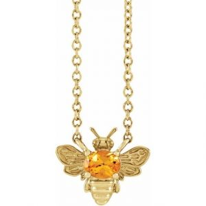 yellow gold bee pendant necklace with orange garnet