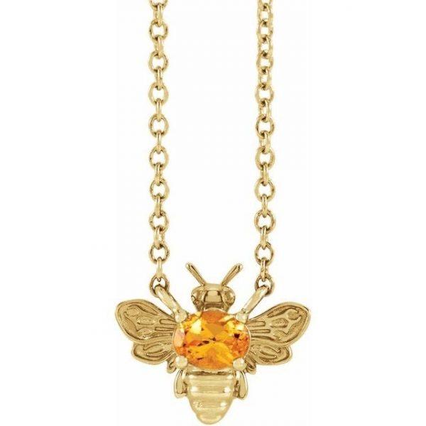 yellow gold bee pendant necklace with orange garnet