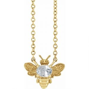 yellow gold bee pendant necklace with white sapphire