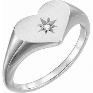 ring with heart shape and diamond starburst
