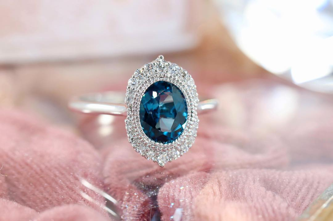 blue topaz ring on a glass table