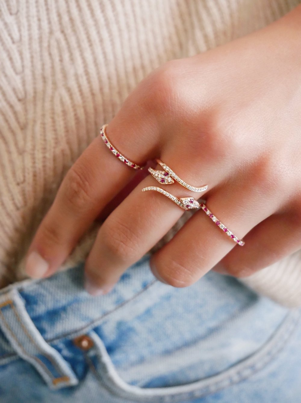 woman with multiple ruby rings on